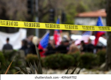 Police line tape used for crowd control at a peaceful protest.