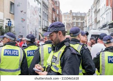 Police make notes during the Al Quds Day rally, London, 10/06/18.