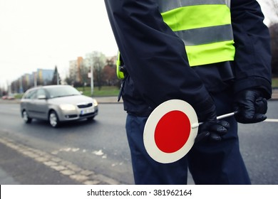 A police man checking the traffic