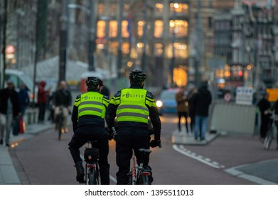 Police Men On Bicycles At Night Amsterdam The Netherlands 2019