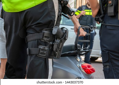 Police Motor Officer With A P99 Gun At Amsterdam The Netherlands 2019