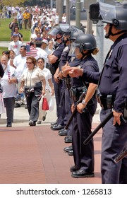 Police offers with batons stop demonstrators at illegal emigrant rally. May 1st 2006