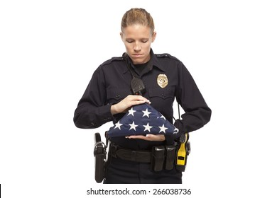 Police officer with American flag looking down