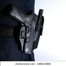 Police officer, Carrying pistol weapon in holster at hip belt, Tactical equipment,tactical gear.