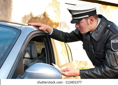 Police officer is doing a traffic check and is looking at a drivers license