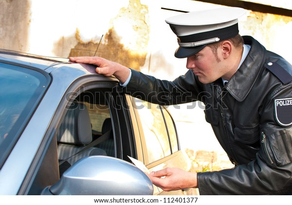 Police Officer Doing Traffic Check Looking Stock Photo (Edit