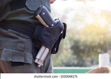 Police officer with gun belt.