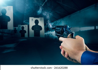 Police officer holding a gun at a shooting range