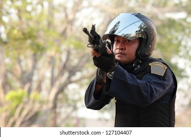Police officer is holding  with a rifle