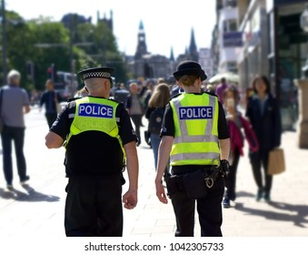 Police officer on duty on a city centre during special event.