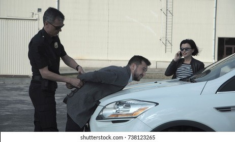 Police officer ordering delinquent to leave the car by aiming pistol and then arresting him.