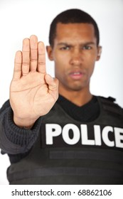Police officer putting his hand up.  Shallow depth of field.