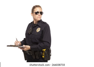Police officer in sunglasses writing report