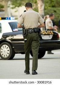 Police officer walking toward his car