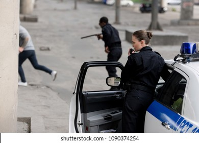 police officers with car chasing thief on street