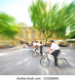 Police officers on bicycles in motion blur.