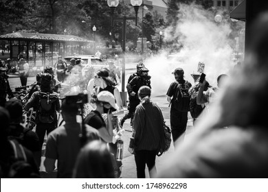 Police officers in riot gear moving towards protesters after tear gas canisters had been used to disperse them from the streets. Columbus, OH 5/30/2020