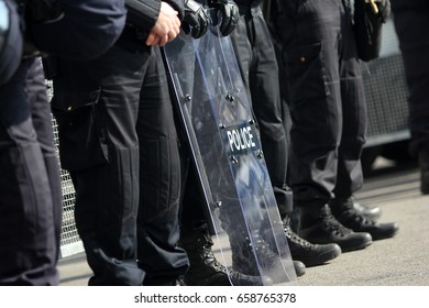 Police officers wearing riot gear