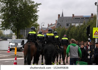 Police On Horses At Work The Climate Demonstration From The Extinction Rebellion Group At Amsterdam The Netherlands 2019