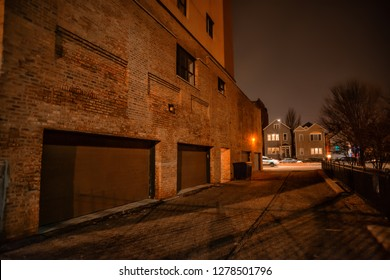 Police patrol car driving by a dark alley at night in Chicago