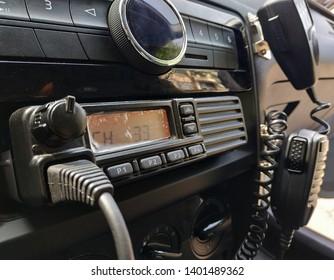 Police patrol car radio equipment and microphone. Walkie-talkie. Selective focus.