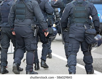 police in riot gear with protective helmet waiting for the fans of the soccer teams before the important match