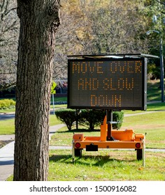 police road sign to move over and slow down