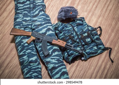 police russia uniform soldiers accessory and gun for toy scale on woods texture and woods backgrounds