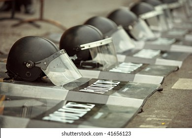 Police shields and helmets laying on the ground