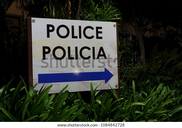 police sign at night