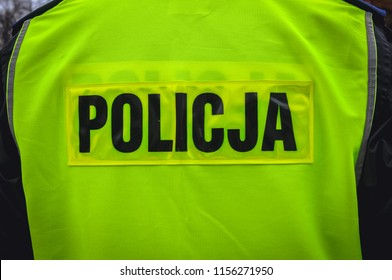 Police sign on a back of police officers vest in Warsaw, Poland