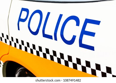 Police sign on the side of a patrol car.
