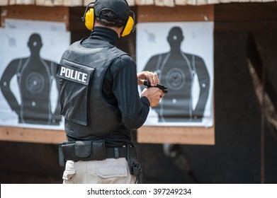 .Police special operations practicing in fire pistol shooting.