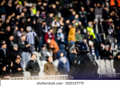 The police at the stadium event secure a safe match against the hooligans