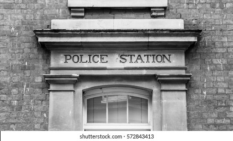 Police Station Carved In Stone Capital Letters Vintage Black and White horizontal photography