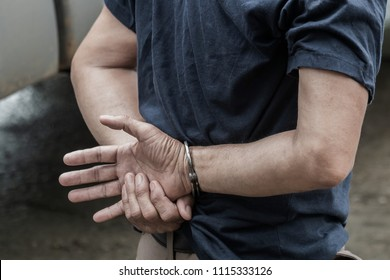 Police steel handcuffs,Police arrested,Police arrested the culprit, the police,the culprit,Arrest the culprit, criminal,Selective focus,noise.
