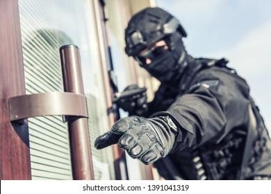 Police SWAT armed fighter ready to break in room