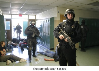 Police SWAT team members practicing an anti-terrorism drill. Editorial use only.