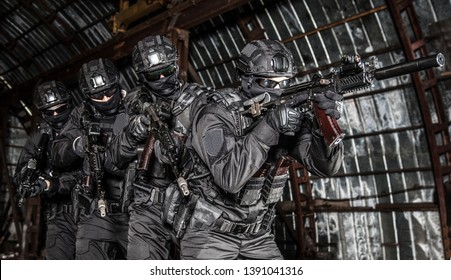 Police tactical group sneaking in industrial area