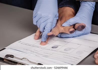 police takes fingerprints of a criminal. law concept.