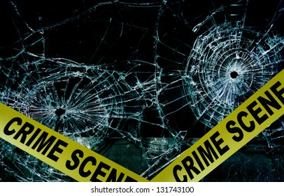 Police tape across broken glass window