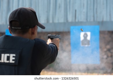 Police trained to shoot short pistol weapons in the shooting field.