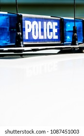 Police vehicle sign with blue lights.