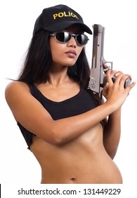 Police woman with a gun isolated on white background. Sexy policewoman with sunglasses holding a gun.  Attractive Asian policewoman with cap standing with a gun on a white background.