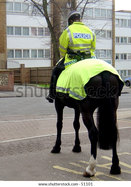 Police woman on a horse
