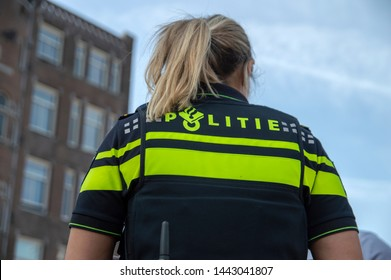 Police Woman With A P99 Gun At Amsterdam The Netherlands 2019