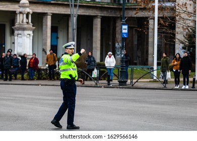 Police woman, Romanian Traffic Police (Politia Rutiera) directing traffic during the morning rush hour in downtown Bucharest, Romania, 2020