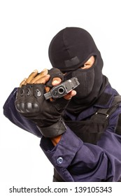 Policeman in black mask targeting with a handgun
