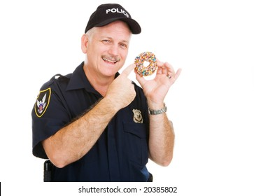Policeman pointing to a delicious sprinkle covered donut.  Isolated on white.