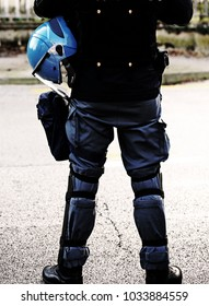 policeman in riot gear with helmets and batons before a football match with dark dramatic effect